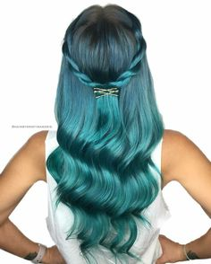 Metallic blue green hair color for wavy long hair with pin hair accessory