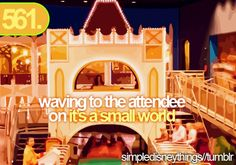 waving to the attendee on it's a small world