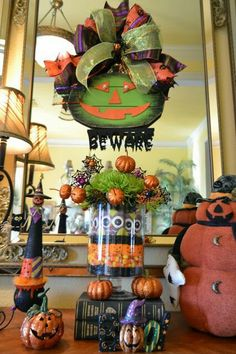 i created a little halloween vignette in my entryway yesterday i made this arrangement out of candy fresh green mums and glittered pumpk