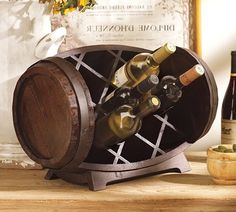 Wine barrel wine rack by Pottery Barn (crafted from a wine barrel and fashioned with storage compartments to create a distinctive display for wine bottles)