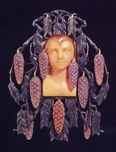 René Lalique 1899-1900 Brooch. Woman's Face Surrounded by Pine Boughs. Silver, enamel, engraved stone.