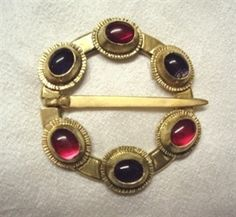 """Oxwich Brooch"" 14th Century This brooch was commissioned by The National Museum of Wales.  Sterling Silver, 18ct gold plated, Simulated Rubies and natural Iolites. Measures 2.5 inches in diameter.  I recreated the brooch in what is considered the original gemstones,(Rubies and Sapphires) as at present the brooch has three Cameos (quiet possibly a later replacement as they are ill fitting)."