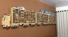 """If you are a hot wheels collector then you will appreciate these display efforts here. Hot wheels have become a """"toy"""" that is not only played with and collected by children. Hot Wheels Display, Hot Wheels Storage, Truck Storage, Hanging Storage Shelves, Ceiling Storage, Large Toy Storage, Wooden Truck, Diy Casa, Kids Bedroom Ideas"""