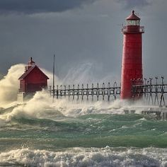 "Grand Haven Lighthouse-Lake Michigan.     Same lighthouse, with the ""winds of November"" threatening the shore."
