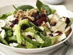 ROMAINE & SPINACH SALAD WITH BALSAMIC VINAIGRETTE - Goat cheese, dried cranberries, a chopped pear, and toasted walnuts make this tossed green salad extra-special.