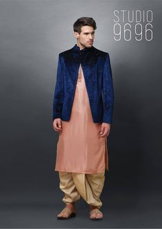 The starry mid-night coloured coat makes the entire outfit dazzle and still looks very much manly