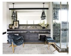 Trip Haenisch turned the master bath in Courteney Cox's private retreat in Malibu into a soft comfortable and relaxing sanctum by introducing a plush silver, grey and blue Oushak rug and velvet upholstered chairs and ottoman.