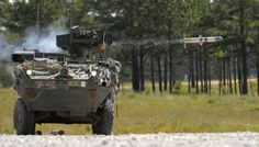 US Army Stryker with a perfectly timed photo. TOW launch