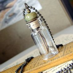 Glass Vial Necklace with Gemstone Bead and Dangling Feather Charm