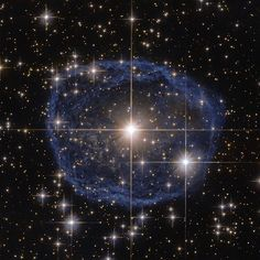 provocative-planet-pics-please.tumblr.com Blue Bubble: Sparkling at the center of this beautiful Hubble Space Telescope image is a Wolf-Rayet star known as WR 31a located about 30000 light-years away. The distinctive blue bubble appearing to encircle WR 31a is a Wolf-Rayet nebula - an interstellar cloud of dust hydrogen helium and other gases. Created when speedy stellar winds interact with the outer layers of hydrogen ejected by Wolf-Rayet stars these nebulae are frequently ring-shaped or…
