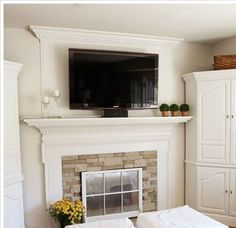 Fireplace remodel idea..mine could look like this with paint and new tile/stone