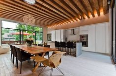 Designed by Gervais Fortin, the team demonstrated that it's possible to build an ecological house without sacrificing the contemporary design. Ecologia Montreal is the first single dweling home in … Interior, Wood Ceilings, Interior Architecture, Interior Spaces, False Ceiling Design, House Interior, Wooden Ceiling Design, Kitchen Table Wood, Modern Kitchen Design