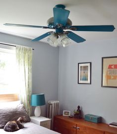 Dress up an old ceiling fan with paint & vintage globes...