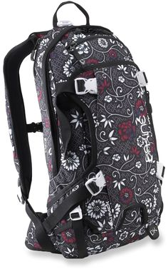 The women's DAKINE Heli 11L snow pack features a lightweight, streamlined design to get you and your essentials in position for the ride of your life.