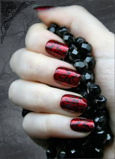 Red nails with black swirls