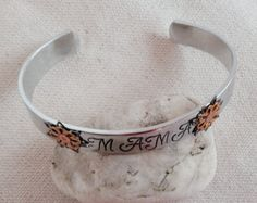 Personalised cuff bracelet for mom. Metal flowers riveted in copper. Kids initials and songbird stamps in back. Smooth or hammered. by glitterazzijewels. Explore more products on http://glitterazzijewels.etsy.com