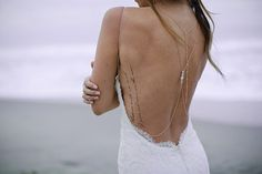 bride with text tattoo on her back rib cage