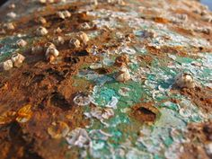 Corrosion: the conversion of a metal into a metal compound by a reaction between the metal and some substance in its environment; ex: rusting involves the reaction of oxygen with iron in the presence of water