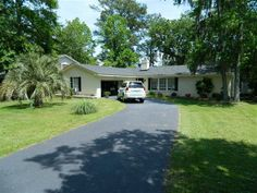 Excellent Condition on the tidal marshes of Battery Creek conveniently located on west side of BeaufortPort Royal close to military bases shopping restaurants and employment. Great location for Bluffton or Savannah commute Spacious 1784 square feet of living space with a 598 2 car garage built in 1978 on nearly half acre lot. Master suite separated from other 2 bedrooms and bath by living dining area kitchen and family room with a fireplace and access to large rear screened porch.