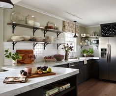 open shelves, white counters, black cabinets
