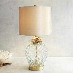 Introduced in Europe in 1493, pineapple was served only by affluent hosts who could afford it. In turn, the fruit became a symbol of generosity, hospitality and, of course, wealth. Create a sense of welcome in your home with our exclusive glass pineapple lamp trimmed in golden steel. And the best part? You won't need to spend a fortune to bring this symbol of warmth into your home.