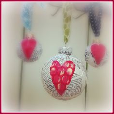 cute repurposed ornament mod podged with vintage book pages and finished with a hand-painted paper heart! could also add a gift tag and use to add holiday cheer - $5