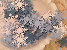 Winter Wedding Confetti - Lot of 150- Snowflake Confetti -White and Shades of Blue - Invitation Stuffers -Holiday Table Decoration. $3.99, via Etsy.