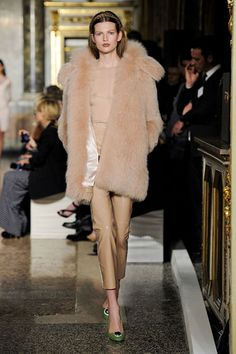 Emilio Pucci Fall 2012.  And if it wasn't see-through, it was the illusion of it, like a giant puff of nude fur over matching turtleneck and cropped trousers. The point: Suggestion can be every bit as sexy as showing skin.