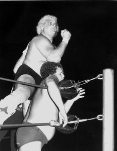 "Dusty Rhodes giving the ""bionic elbow"" to Harley Race during their NWA wrestling match - Key West, Florida"