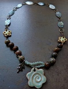 Use purple-brown chariote with pale blue grey OR Aventurine rondells