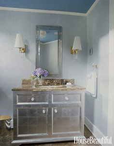 In a subtle variation on the standard shine of chrome and mirrored glass, designer Sally Markham evokes boudoir glamour with a vanity sheathed in silver leaf.