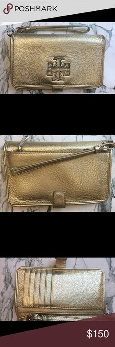 Tory Burch Wristlet - Fits an iPhone 6 Gently used Wristlet - belongs to a friend - price is not negotiable, sorry. Tory Burch Bags Wallets
