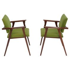 Stunning and Beautiful Italian Arm Chairs In the manner of Ico Parisi | From a unique collection of antique and modern armchairs at http://www.1stdibs.com/furniture/seating/armchairs/