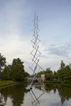 Title: Virlane Tower.  Artist: Kenneth Snelson.  Period: 1981.  Material: stainless steel.  On view in the sculpture garden