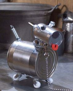 50 Jaw-Dropping Ideas for Upcycling Tin Cans Into Beautiful Household Items! 50 Jaw-Dropping Ideas for Upcycling Tin Cans Into Beautiful Household Items! Aluminum Can Crafts, Tin Can Crafts, Dog Crafts, Crafts For Kids, Arts And Crafts, Animal Crafts, Recycled Tin Cans, Recycled Crafts, Recycled Robot