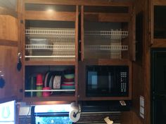 Rubbermaid shelving with edge up to keep things on shelves, magazine holders for plates to keep from rolling out and spring loaded curtain rods to keep lower shelf items in place, cheap, light weight organization solution to these vast toy hauler cabinets