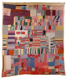 Strip quilt made of housetop strips and triangles Louisiana, c. 1940s, mixed fabrics, 72 x 82 in