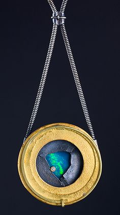 Andy Cooperman - round rich gold pendant with freeform opal at center