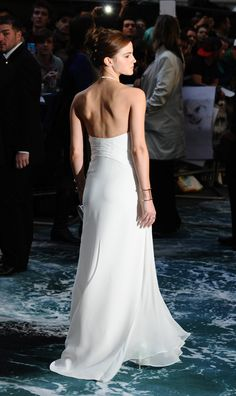 Emma in that white dress, from the back.