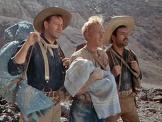 """John Wayne, Harry Cary Jr and Pedro Armendáriz in John Ford's """"3 Godfathers"""". A wonderful film, more heartwarming than """"shoot 'em up"""", with strong undertones of the Gospel's telling of the birth of Christ. One could almost classify this film as a Christmas movie. Pedro Armendáriz was amazing. Ford brought him along for Fort Apache, a year later, where he was terrific yet again."""