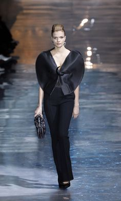 Armani - the black shapes which cover the bodice appear like a butterfly - a charming idea, rendered subtly, without becoming cutesy. It's a hint in the background. The design seems to have designed itself.