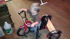 On his new trike that Granny got for him!