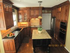 kitchen - honed granite, stained cabinetry, different color island...that's the direction I'm going
