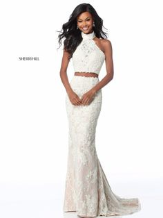 aad65d06e784 Romance is on the rise in Sherri Hill This sophisticated two-piece lace  gown includes a halter top with a high neckline