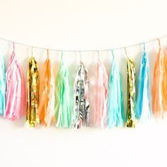 Tissue paper tassel garlands add so much personality to any occasion, and add a lovely pop of color to your party decor.