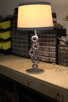 Re-Cycle-D Vintage 1982 Yamaha motorcycle parts table lamp. I've got plenty of this stuff lying around. Car Furniture, Automotive Furniture, Automotive Decor, Furniture Design, Support Bougie, Lampe Steampunk, Custom Motorcycle Builders, Lampe Metal, Car Part Art