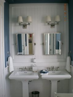Small well utilized bathroom space double pedestal sink