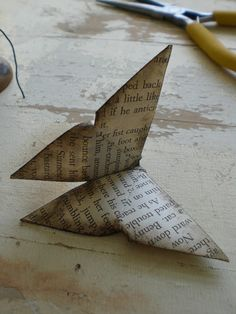 Origami butterfly - the thought of folding a book gives me rage, but this is just so sweet :)