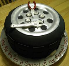 fondant covered truck tire with chocolate molded tools, nuts, bolts. THanks to all the cc inspiration and help when I was stuck trying to place my inscription- Ended up on the cake board and worked perfectly with the design