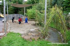 shade structure, willow tunnel, and shallow stack of stumps Playground Build & Design | Natural, Wood | EarthWrights
